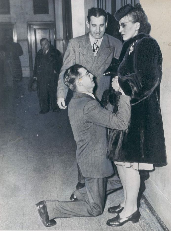 vaginawoolf:   A man begging his wife's forgiveness inside Divorce Court, 1948, Chicago.  #push him over