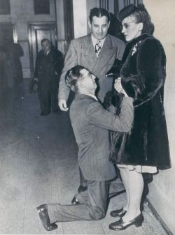 lorygilmore:  ch0p-suey:  kissmyafro: A man begging his wife's forgiveness inside Divorce Court, 1948, Chicago. Bad bitches vintage edition  I reblogged this picture