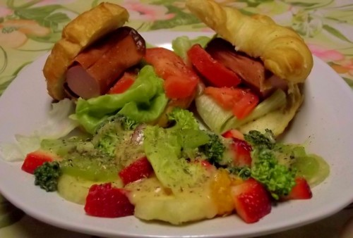 My Food Diary June 29, 2012 I baked (yes, baked) the chicken hot dogs yesterday since I was baking a chicken breast anyway. See My Food Diary June 28, 2012 for photo, etc.  I cut one chicken hot dog in half, placed each on a croissant with lettuce and tomato.  Fruit salad can be made with any fruits you have.  I had kiwi, strawberries, mandarin oranges,and banana today. I don't always add salad dressing but today I did use low-fat Thousand Island Dressing. Super easy, fast, and healthy. Thank you for reading my blog. *My methods or ingredients may not be for everyone. I added no salt or oil. croissant was less bread than a hot dog bun. I keep a food diary for medical purposes—my own choice.