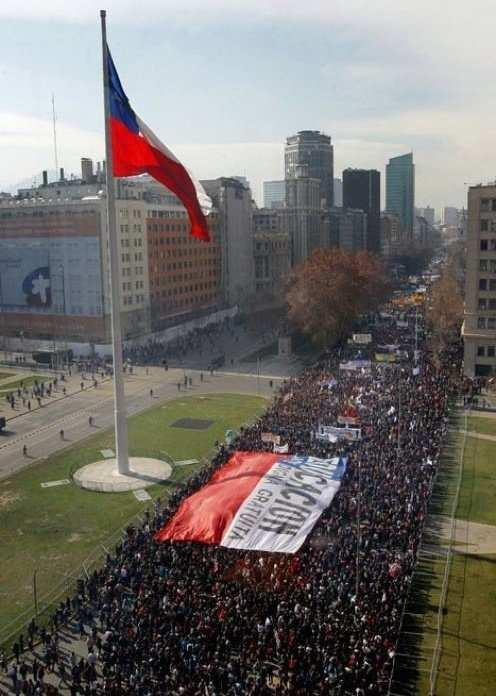"Largest student protest of 2012 in Chile draws 150,000June 29, 2012 Rain slowed, but did not stop massive files of students, workers and protesters as they marched past the presidential palace to protest education costs and profiteering Thursday. The Confederation of Chilean Students (Confech), the university student organization that coordinated the protest, estimated the number of protesters at 150,000. ""The government is right to be worried because we are dealing with a minister who bows to business,"" said Confech Spokesperson Gabriel Boric at the march's closing ceremony. ""We want to say that while this happens, we will not be quiet. We went from a military dictatorship to a market dictatorship.""In Chile, the majority of education costs are borne by private citizens. Confech and other student organizations have called for the government to take a more active investment.In addition to the movement's broad call for education reforms, many protesters specifically spoke against profiteering in the educational system. At least seven universities are under investigation for taking money from the instruction and putting it into the pockets of its directors and executives.This was the movement's third major protest of the year, but first sanctioned route past La Moneda presidential palace. It was also the biggest of the three, according to the Confech estimate. Source"