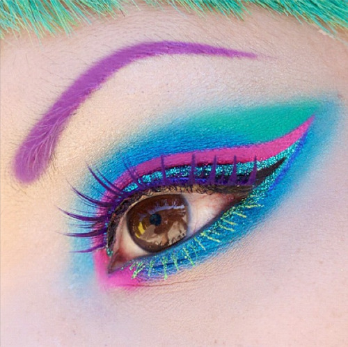 sugarpillcosmetics:  EOTD: Sugarpill Afterparty, Mochi, Dolliopop, Angel Baby lashes; Inglot gel liners 72 & 73, Lit Cosmetics Cayman and Mary Jane glitter.  http://instagram.com/p/MeggoMlIQo/  My Dyke March outfit is going to be turquoise and hot pink, and this is my makeup inspiration. Amy Doan is ridiculously fabulous!