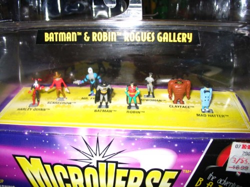 "Before the Hasbro/Kenner conglomerate purchased rival toymaker Galoob, they attempted to compete with Galoob's MicroMachines via their own series of miniature figures, vehicles and playsets, collectively known as MicroVerse. Since Kenner held the Batman license at the time, they produced a few MicroVerse sets related to Batman: The Animated Series / The Adventures of Batman and Robin, including this tiny rogues gallery pack. Each figurine is roughly the size of a fingertip. Personal photo taken in 2005, though I think the set itself was released concurrently with the show. Also: KB Toys ""clearance"" sticker!"