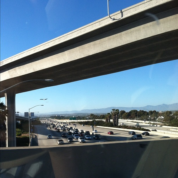 We were on our way to this #event for my sister on the #freeway. It was a nice #view as we headed towards #LAX. #airport #overpass #traffic #car #cars #road #landscape #city #la #nofilter #instagram (Taken with Instagram)