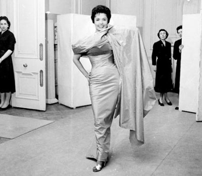 vintageblackglamour:  Lena Horne was born in Brooklyn, New York, 95 years ago today. In this photo  from May 1956, she is trying on a dress - and wearing those saleswomen out… Photo: William Lovelace/Express/Getty Images.