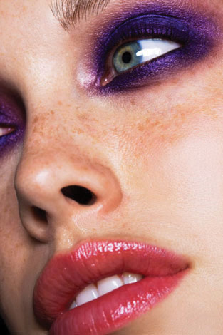 "Smudgy rich-purple smoky eye — Off the catwalks, people avoid too much shadow under the eyes. Not everyone likes smudgy-looking makeup, but when it's done tastefully, it can look grungy and sexy, rather than just ""a mess"". This look necessitates applying shadow under the eyes though, so if you have very pronounced bags right beneath your eyes, go for shades that are a bit more satin or matte. If your eye contours are quite flat and you want them to be more pronounced, go for more shiny/metallic shades. To get this look, just follow this tutorial, but swop out the black and blue shadows with a deep, rich, royal purple. Then make sure you apply black pencil on the tightline and waterline, before your mascara. On the lips, just apply a natural-colored lip pencil all over and rosy tinted gloss or balm. [Photo source: http://makeupandbeauty.com/]"