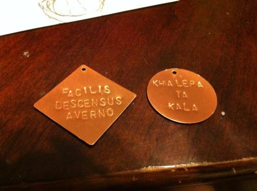 Pendants with the Shadowhunter motto and Jem's Greek saying! Facilis descensus Averno - The descent into Hell is easy. Khalepa Ta Kala - Beauty is harsh. I might oxidize (darken the words) so you can see it better but I want to wait until sunlight to see how they look.
