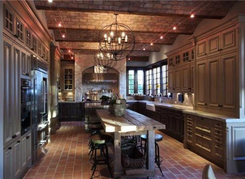 Beautiful dark kitchen! Love the industrial style chandeliers and the wavy brick ceilings. Follow CollegeGuyDesign if you like things like this showing up on your dash!