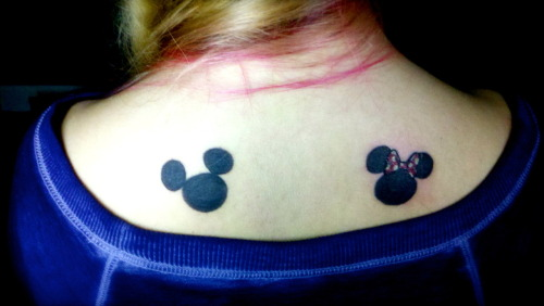 That is my first Disney tattoo with at least two more to come! I dedicated these little guys to my Godparents Annie and Robert who took me in as one of their own grandchildren when I had no relation to them whatsoever!  They took me to Disney World for my first time when I was about 4 years old.  To me they are the embodiment of Mickey and Minnie Mouse.  I love them with all my heart and I know they'll always have my back (quite literally now!). dfordisney.tumblr.com is my Disney devoted blog and my personal is livelife-loveliving.tumblr.com
