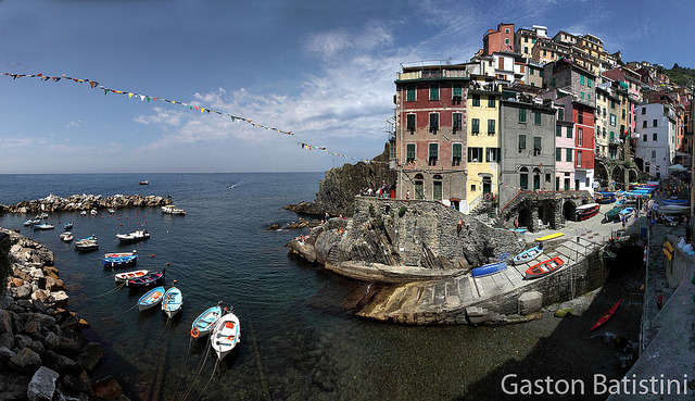 "Riomaggiore, Cinque Terre, Liguria, Italia by Batistini Gaston on Flickr.Via Flickr: Canon 5DMKII, Lens 16/35mm @ 16MM Some photos stitched covering about 180° The Cinque Terre is a rugged portion of coast on the Italian Riviera. It is in the Liguria region of Italy, to the west of the city of La Spezia. ""The Five Lands"" is composed of five villages: Monterosso al Mare, Vernazza, Corniglia, Manarola, and Riomaggiore. The coastline, the five villages, and the surrounding hillsides are all part of the Cinque Terre National Park and is a UNESCO World Heritage Site. Over centuries, people have carefully built terraces on the rugged, steep landscape right up to the cliffs that overlook the sea. Part of its charm is the lack of visible corporate development. Paths, trains and boats connect the villages, and cars cannot reach them from the outside. The Cinque Terre is a very popular tourist destination."