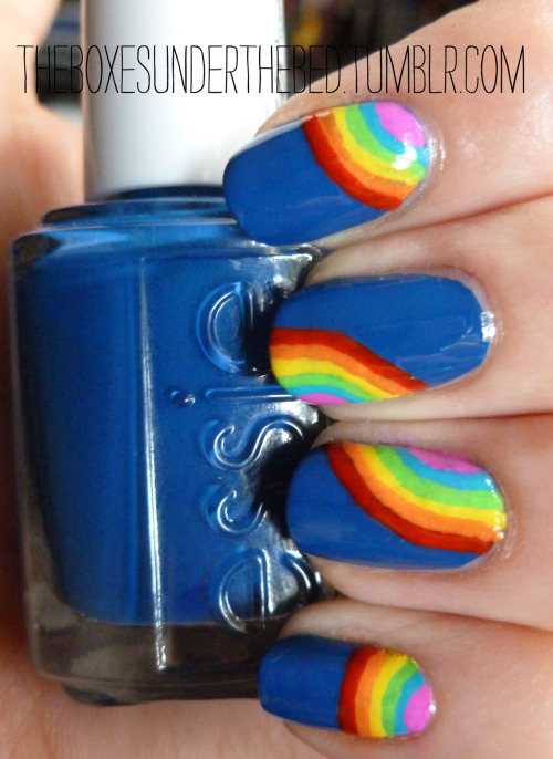Rainbow Nails In celebration of the fact that I have a camera again some quick rainbow nails. Base colour is Essie Mesmerize. Totally worth having the postman wake me up before 8:00am on a Saturday!