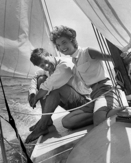 whiteandblacksuicide:  Jacqueline Bouvier sitting with her fiance, Sen. John Kennedy, on the deck of small sailboat as they cruise the waters of Cape Cod on July 7, 1953.