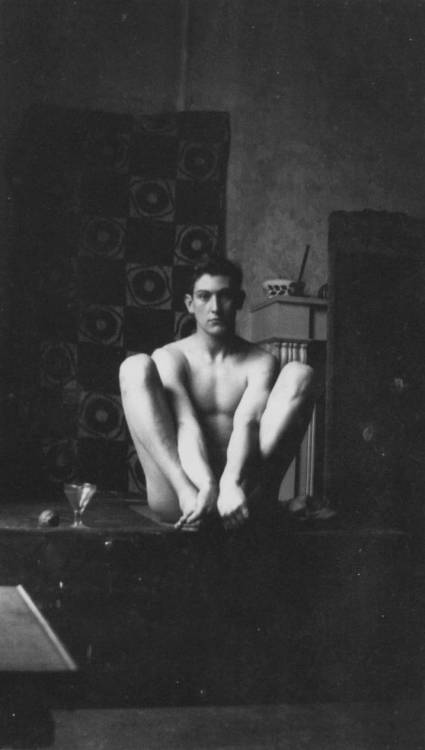 "This is George Mallory. Alive, in 1912. Usually when I do my ""This is So and So"" posts, I show you a picture of them dead. That's not the case here (though Dead George is a sight to behold): I like Alive George much, much better. Mallory disappeared in 1924, on his third expedition to Mount Everest, along with his climbing partner, Andrew ""Sandy"" Irvine. It wasn't until 75 years later, however, that Mallory's body was discovered. On May 1, 1999, mountaineer Conrad Anker found Mallory's frozen (and pretty much perfectly preserved) body on Everest. Here's a video about it. It's re-enact-y and overly dramatic, but it gives you an idea of how he was found. From Wikipedia:  Within hours of beginning the search on 1 May, a frozen body was found by Conrad Anker at 26,760 feet (8,160 m) on the north face of the mountain. As the body was below where Irvine's axe was found in 1933, the team expected the body to be Irvine's, and were hoping to recover the camera that he had reportedly carried with him. They were surprised to find that name tags on the body's clothing bore the name of ""G. Mallory."" The body was remarkably well preserved, due to the mountain's climate. The team could not locate the camera. Experts from Kodak have said that if a camera is ever found, there is some chance that its film could be developed to produce printable images, if extraordinary measures are taken.  Anker's team held an Anglican service for Mallory and covered his body with a cairn.  Image: George Mallory photographed at 38 Brunswick Square, London, age 25 or 26. Via Front Free Endpaper, whose post on Mallory is super, though NSFW (if you consider a very attractive man's full back-al nudity NSFW)."