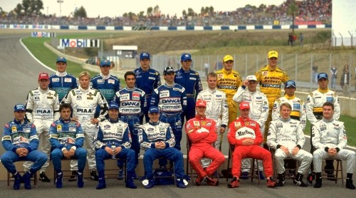 f1pictures:  1997  Jerez, season round up. Back row: Johnny Herbert, Nortbeto Fontano, Olivier Panis, Shinji Nakano, Giancarlo Fisichella (current Ferrari test driver),  Ralf Schumacher. Middle row: Jos Verstappen, Mika Salo, Pedroa Diniz, Damon Hill, Jan Mangussen, Rubens Barrichello, Ukyo Katayama, Tarso Marques. Front row: G-man, Jean, Heinz Harold Frentzen, Jacques Villeneuve, Michael Schumacher, Eddie Irvine, Mika Hakkinen, David Couthard. The only man here still racing in Formula One is Michael. There are eleven world championships present in this photo.