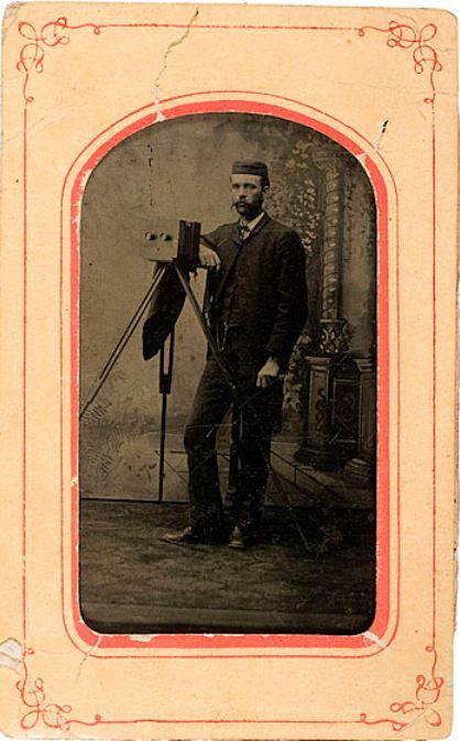 ca. 1880-90's, [tintype portrait of a gentleman with his stereoview camera] via Cowan's Auctions