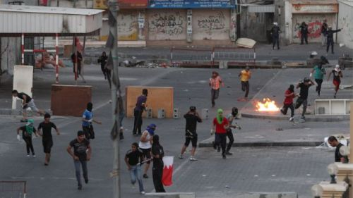 thepeoplesrecord:  Security forces clash with protesters following an anti-Al Khalifa regime demonstration in Sitra, Bahrain, June 28, 2012. Police forces retaliated with tear gas and rubber bullets.