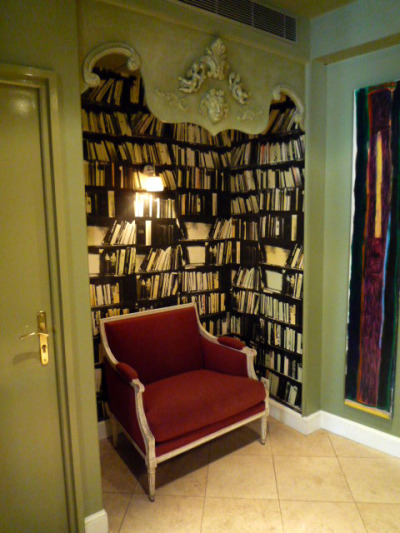 bookshelfporn:  Reading nook at l'Hotel du Petit Moulin designed by Christian Lacroix.