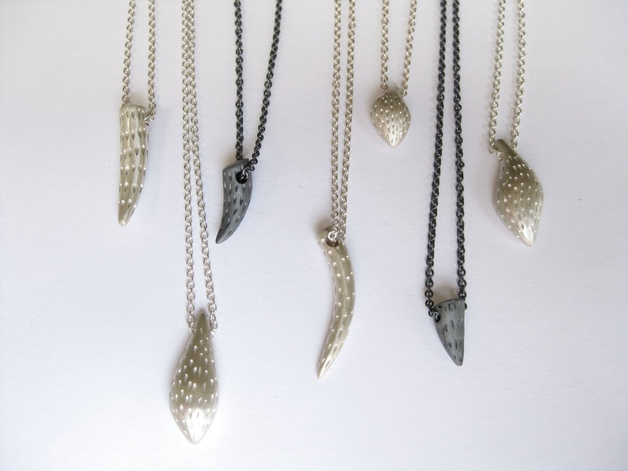 Various Little Tail pendants by Karla Way.