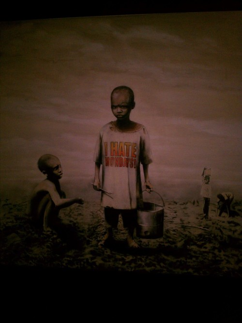 took this picture at the LA Moca art show, its one of Banksy pieces.