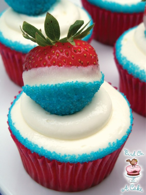 DIY Red White and Blue Cupcakes Topped with White Chocolate Dipped Strawberries. I know I just posted the same strawberries (from a different blog), but I just saw this on Bloglovin and the cupcakes are from a mix (lazy, I know) and the frosting is an easy cream cheese recipe with the dipped strawberry on top. Recipe and tutorial from Bird on a Cake here. *First seen at The 36th Avenue here.