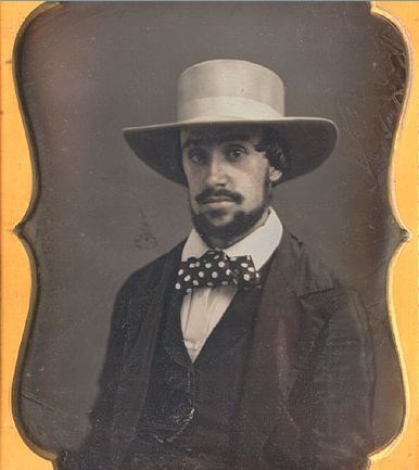 ca. 1850-60's, [daguerreotype portrait of a mustached gentleman in a polka-dot tie and wide-brimmed straw hat] via Christopher Wahren Fine Photographs, Skylight Gallery