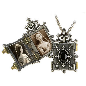 I have this locket, and the photo in it is of my dearly departed Dread Beastie cat.  skeletalroses:  I want one for my cats. Because I am that much of a crazy cat lady.
