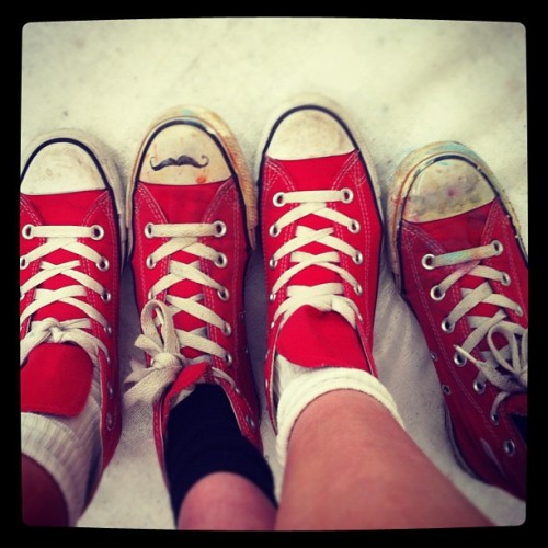 Mine and my sisters #converses #dirty #red #shoes #paint #drawing #black #whatimwearing #young #painting  (Taken with Instagram)