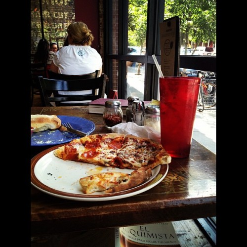 Yummy lunch with a book.  (Taken with Instagram at Pasquini's)