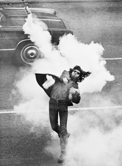 firsttimeuser:  Anti-War Demonstrator Throwing Tear Gas. Tuesday, May 05, 1970