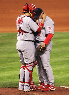 A catcher pulling his pitcher to him, giving him a word of confidence. In that moment, in that stadium, there is nothing more sincere and down right sexy. (Yadier Molina of the St. Louis Cardinals)