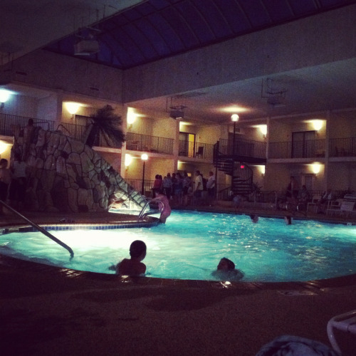 Kids playing in Adventure land hotel pool such a romantic atmosphere and live off of atmosphere