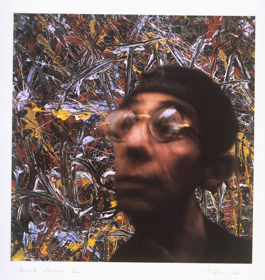 Richard Hamilton | Portrait of Derek Jarman (1996-7) Shortly before the death of the filmmaker and painter Derek Jarman in 1994, the Director of the Tate Gallery gave a lunch in his honour in the Tate Board Room. Hamilton, who was among the guests, took a number of colour Polaroid photographs of Jarman during the lunch and selected one of them as the basis for the eventual image in a painted portrait. That painting by Hamilton shows Jarman's bespectacled head, wearing a cap, in front of his 1993 oil painting Ataxia - Aids is Fun (Tate Gallery ), which was hanging in the Board Room during the lunch. The title focuses attention on the suffering of those with Aids (and, in this case, also with Ataxia, an affliction of the central nervous system), of whom Jarman was one. [via Tate]