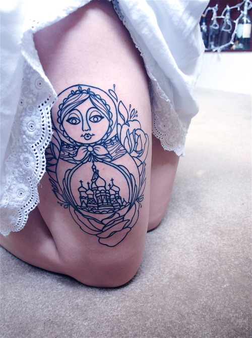 fuckyeahtattoos:  I got this matryoshka doll on my right thigh just yesterday. On her belly is the Saint Basils Cathedral in Moscow. Though she's not finished yet (3 more weeks!), I am so proud of her. Sam King at Golden Spiral located in downtown Greensboro, NC, drew her up for me, exactly how I imagined her, and put her on my thigh permanently. He's super awesome and after getting this second tattoo done by him, I will be returning to him for most, if not all, of my tattoos. I got her to forever remember the kids brought over from Russia through my church ever since I was the age of four. Each of them over the last 16 years has touched my heart, whether they were here for one summer or they continuously came until they aged out at 17. I will have a connection with each of them until the day I die. I see the younger kids each summer, and those that have aged out, I keep in contact with through Facebook or Skype. By getting this tattoo, I wanted them all to know how special they are to me and that each doll they brought over every summer they visited was not just another matryoshka doll. To my family overseas, I love you.