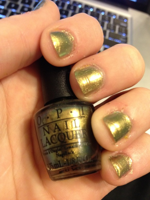 OPI - Just Spotted the Lizard! (the Amazing Spider Man collection) Hello all! I apologize for my long absence from this blog. After letting my pinky nail grow out, it was banquet/graduation time and I got acrylic nails which, after removing them, had left my nails really weak and disgusting. As you can probably see from the picture above, my nails still have not completely grown out yet. Anyways, I was at Ulta the other day and was eager to try out some of the new OPI polishes. Just Spotted the Lizard immediately caught my eye and I was eager to try it out. Let me tell you - this picture does not do the polish justice at all. It is a gorgeous gold/green duochrome that applied flawlessly in two coats. Apparently it is also an exact dupe for Chanel's Peridot. I only have the tiny bottle but, now that it's on my nails, I really want to go back and purchase the bigger bottle. It is such a gorgeous color!