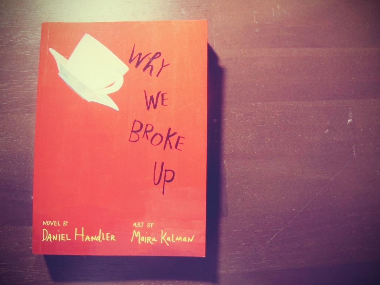 12 in 2012 Why we broke up by Daniel Handler. For June I decided I needed to get back to reading books that were non-school related. I passed this book several times at the store but my sister said she would judge me if I bought it. I heard her voice in my head all the way to the counter, telling me that I would just get all sad again reading this. I must admit, it did hit me at some points in the story that I probably wasn't ready to read a break up book, but I continued reading. I ended up absolutely devouring this book. It was wonderful, despite the roller coaster of emotions I was feeling chapter after chapter.  I couldnt put it down! there were so many parts of the book where I had to stop reading to text my friend, Abe, and tell her how sad it was making me! (and how I needed her to read the book because I knew she'd understand!). So i'm telling all of you, go to the bookstore and get Why we broke up by Daniel Handler - FYI he's Lemony Snicket so expect great things from this book!