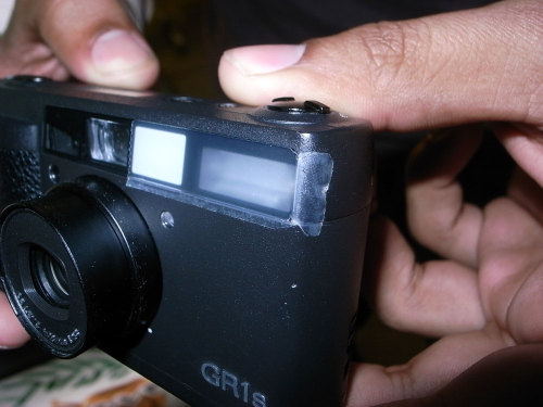 I do this a lot, taping over flashes, it gives a nice warm feeling, easy filter!