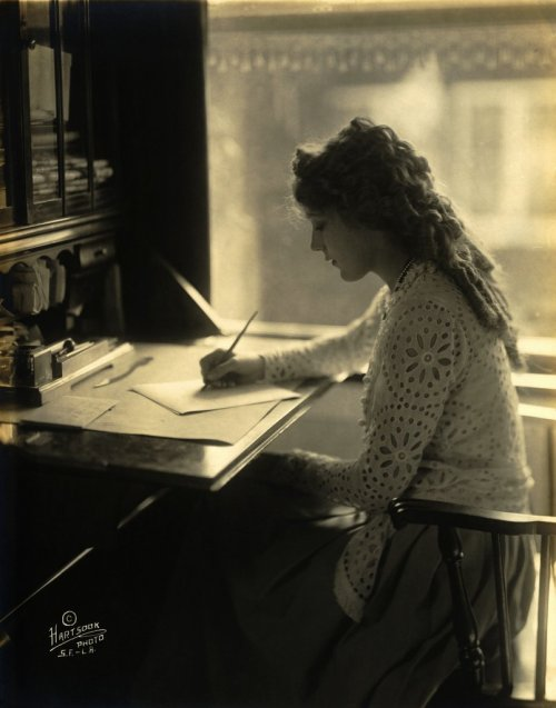"books0977:  Mary Pickford. Hartsook Photo, S.F. - L.A. Fred Hartsook (American, 1876–1930) was owner of a California studio chain described as ""the largest photographic business in the world"" at the time, who counted Henry Ford, Charles Lindbergh, Mary Pickford, and sitting President Woodrow Wilson among his celebrity clients.  Pickford (1892-1979), known as ""America's sweetheart,"" was a legendary film actress during the age of silent pictures. She often appeared on screen in young girl roles, even when she was an adult."