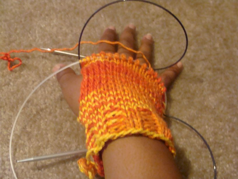 Knitting on some fingerless gloves off the top of my head. I've been using this as a learning experience for understanding patterns. While knitting I try to keep track of the number to do alternating ribs and decreases and when to knit in circular and when to stockinette to create the thumb hole. I also think I may go back and pick up stitches to put some length on the thumb hole.  I know that these are all things I could easily learn on the internet or a class but I am so much the kind of person who has to walk through the mental process. Tonight I've gotten to the ribbing at the base of the fingers. Also, I started this project using cotton yarn even though I knew it would not hold its shape. I just really loved the colors and wanted to make something not a hat, scarf or shawl with it. Once I have all the details I'm going to try again in wool.