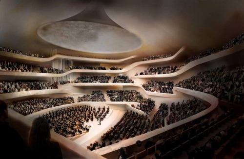 pacificsymphony:  classicalliterature:  Herzog & de Meuron's philharmonic hall on the river Elbe in Hamburg. Called Elbphilharmonie, the project involves installing the Swiss architects' new glass structure atop a red brick warehouse built in 1963 by the late Hamburg architect Werner Kallmorgen. The building will comprise three concert halls, a hotel, apartments, and a public square elevated 37 metres above the river. Construction is due for completion in 2012.  That is a cool looking concert hall!