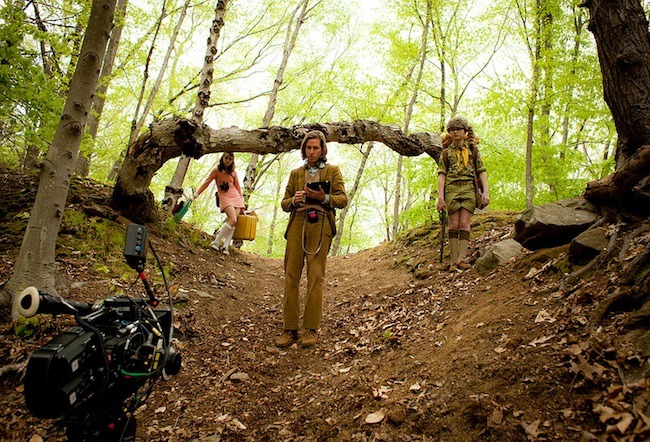 Director Wes Anderson on the set of Moonrise Kingdom with actors Jared Gilman and Kara Hayward.