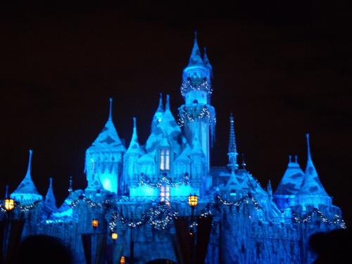 Sleeping Beauty's castle at Christmas time. I wonder if they have it Halloween colors during the fall
