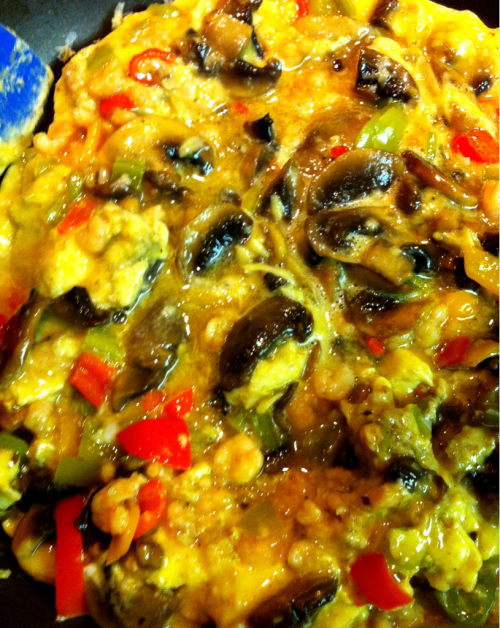 Making Frittata - Serrano & Sweet Peppers, and Mushrooms sautéed in Pasture Butter with Tiny Shrimp, and topped with Avocado, Cilantro, and Thai Basil.