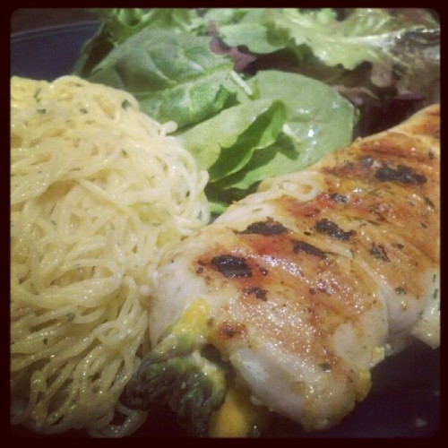 Chix stuffed w/asparagus+cheese / angel hair / mixed green. I couldn't even do half. :/ #foodporn #cooking (Taken with Instagram)