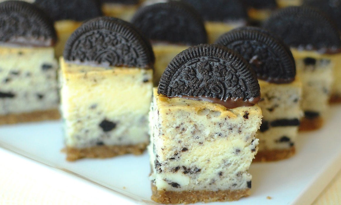 aperture24srecipes:  Oreo cheesecake Base 140 g Digestive biscuit 110 g Oreo biscuit 50 g Sugar 90 g Soft butter A little Cinnamon Orange zest from half orange Crush the biscuits finely and then add the butter, sugar, cinnamon and orange zests and process until well combined. Press the mixture on the bottom of a greased pan to evenly cover the base. Place in the fridge while making the filling. Cake mix 370 g Cream cheese 150 g Sugar 2-3 pcs Eggs (2 large or 3 small) 80 g White chocolate A little Orange zest ½ tsp Vanilla essence A little fresh Vanilla 170 g Oreo biscuit To make the filling, use electric beaters to beat the cream cheese, sugar, eggs and vanilla essence in a medium bowl until the mixture is light and creamy. Now add the melted chocolate and the crumbled oreo biscuits. Alternatively you can put whole biscuit in the cake, as seen on my other photo. Pour mixture into the prepared baking pan and bake in a water bath at 130 c for 2 hours. Gently baking is key to a perfect cheesecake. A good way to check if the cake is done, is to take the cake's core temperature. The ideal temperature is between 70 to 72 degrees C. Once the cheesecake has been removed from the oven, it needs to chill thoroughly, ideally overnight.
