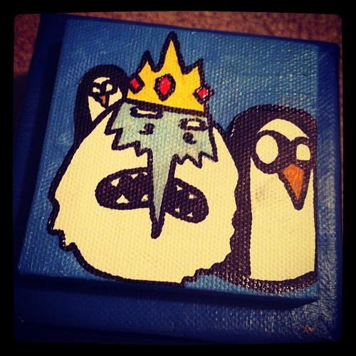 Adventure time painting of the Ice King with Gunter and Goonter. The Ice King really needed a hot profile pic for his online dating site but those smelly penguins wouldn't quit jumping in the way. He'll never find a princess now!This awesome guy is painted on a 4x4 staple back square canvas, with a 3X3 staple back canvas accent which gives it a 3D effect. This painting is ready to hang. International shipping upon request. Check out the other adventure time paintings I have!If you are interested in buying all of 6 square adventure time characters, you can order them in a special listing for $125. click here.