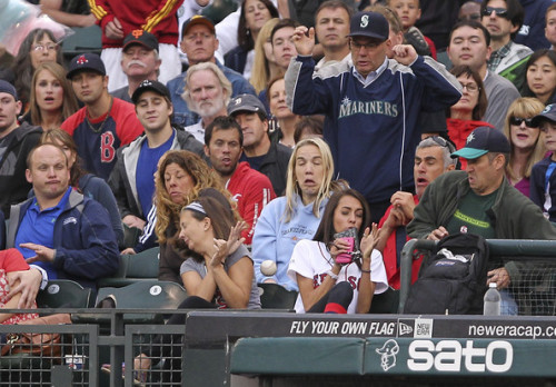 baseball-heaven:  A foul ball bounces into the first base stands during the game between the Seattle Mariners and the Boston Red Sox.