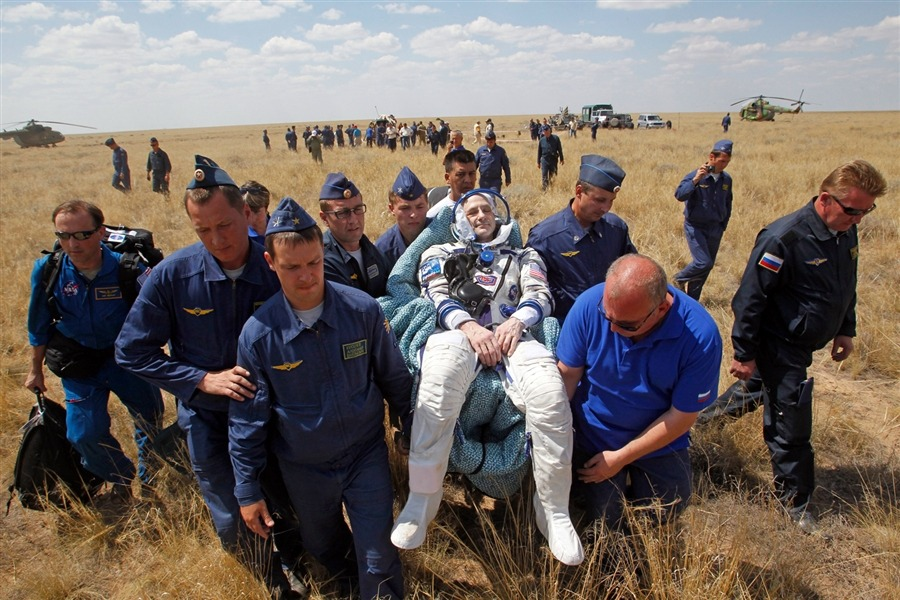 Space station trio gets down to Earth in Russian capsule After half a year living on the International Space Station, three astronauts safely returned to Earth on Sunday aboard a Russian-built space capsule. The Soyuz spacecraft landed in the Central Asian steppes of Kazakhstan at 4:14 a.m. ET, returning NASA astronaut Don Pettit, Russian cosmonaut Oleg Kononenko and Dutch astronaut Andre Kuipers to their home planet. Read the complete story.