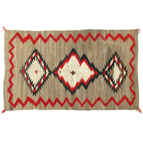 "Large antique Red Mesa Navajo rug 7'4"" x 4'9"". This type of rug is known as a ranch rug, as it was specifically designed and made for the large ranch houses that were common in the Red Mesa region around 1910. Rare large size with expertly made wavy red border, barber striping, and outlines; all without any bleed to the dye. Asymmetric diamond lozenge center. Minor wear and old repairs throughout."