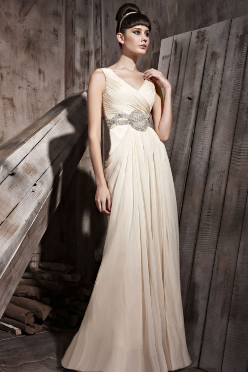 Genoa Cream Chiffon Embellished Wedding Dress £360.00  Highly sophisticated cream wedding dress featuring sleeveless A line silhouette, floor length chiffon skirt, ruched V neckline with grand looking silver belt. Send us a message to inquire about our plus size or if you like this dress in another colour of your choice