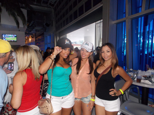 Showing off their new Marlins hats at The Clevelander. #BaseballMiamiStyle!