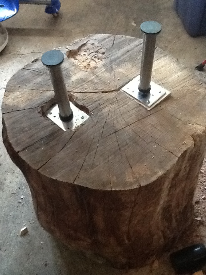 "Countersinking the log table.     Super hot day today.  My family is at our neighbor's pool, so I snuck into the garage to work on this DIY log table.   I used CAPITA metal table legs from Ikea (6""). Then I did my best to countersink the table leg mounts as the log itself isn't cut straight on one side."